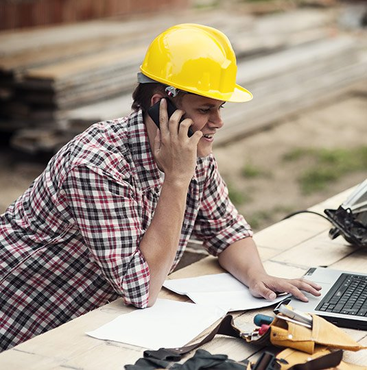 Renovation Contractor on phone working